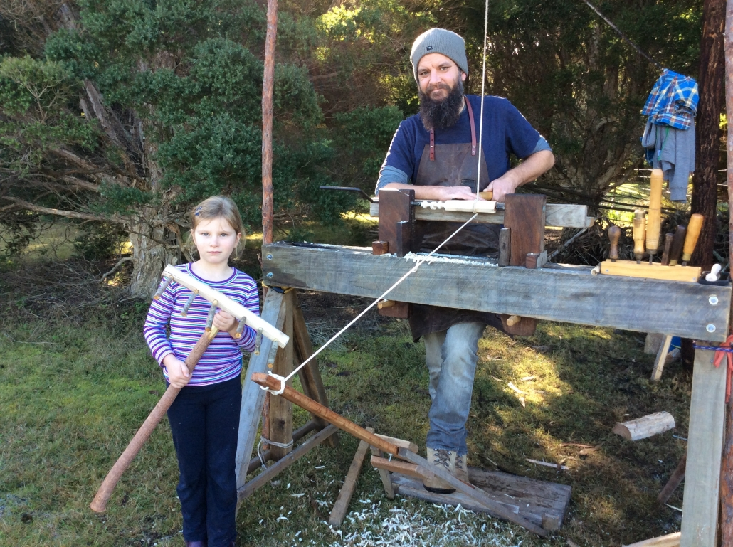 Foot powered pole lathe with student and teacher
