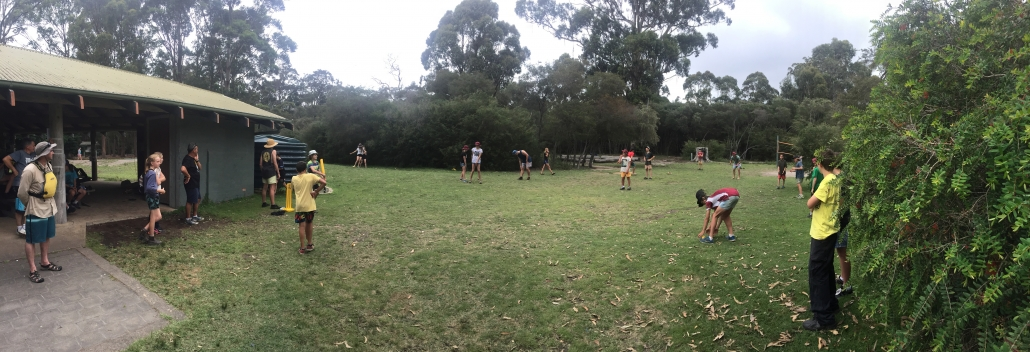 "Students playing ""backyard"" cricket while camping in the National Park"
