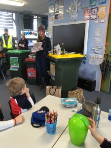 Council staff talking with students about recycling