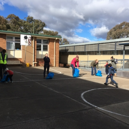 students running a waste relay
