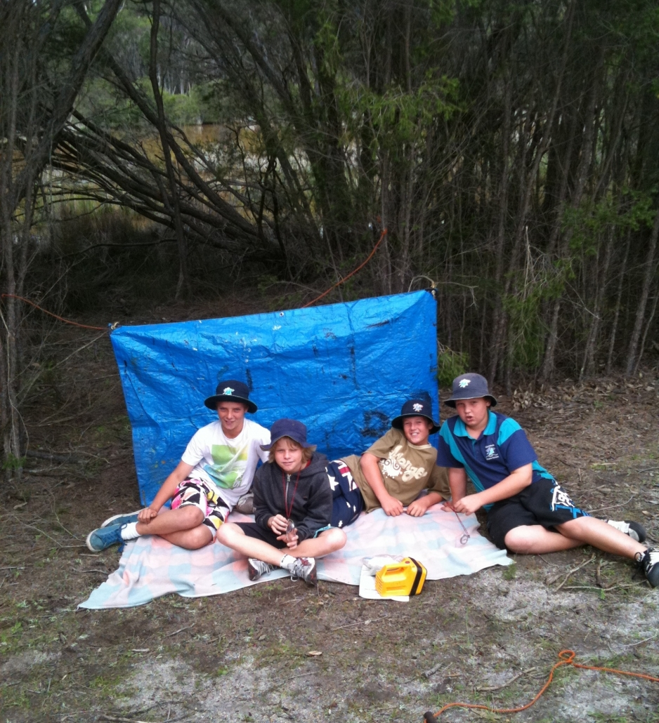 students with their shelter in bushcraft survival
