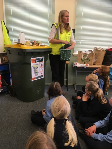council staff talking with students about waste
