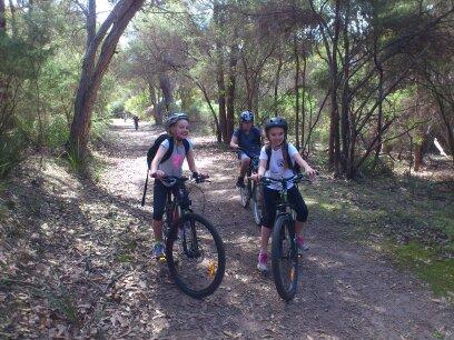 Students riding bikes