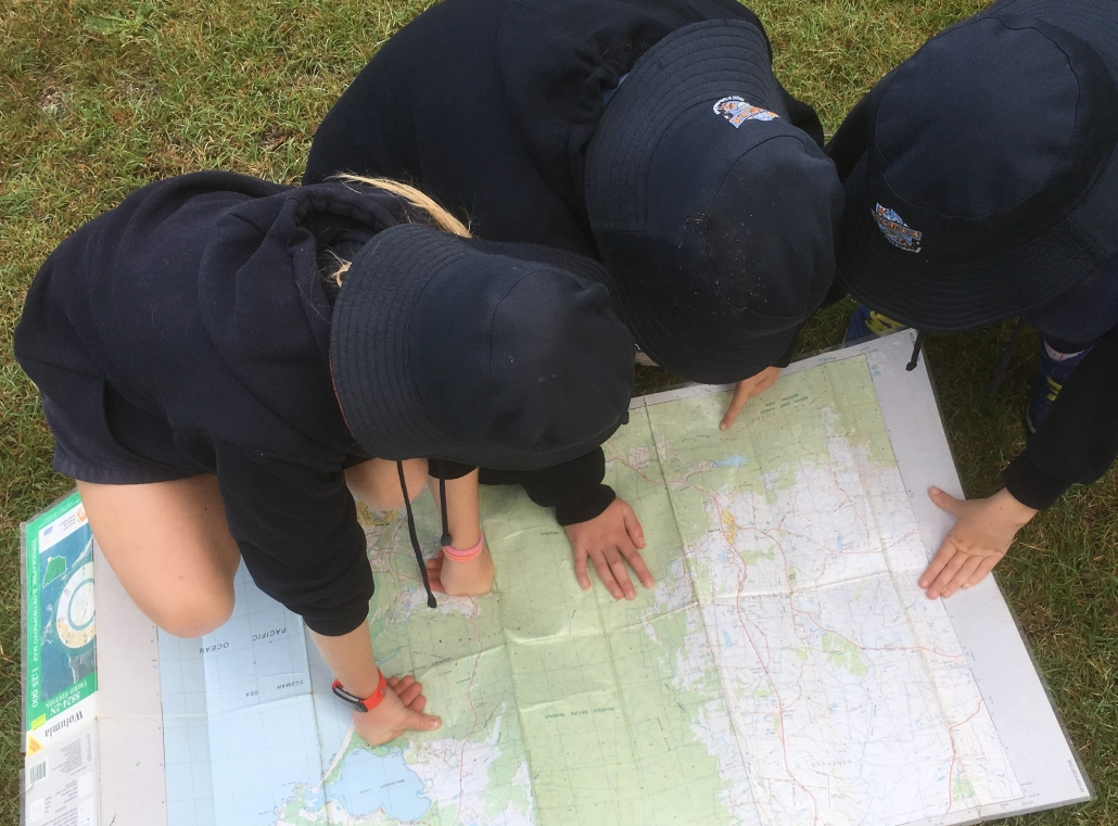 students reading maps