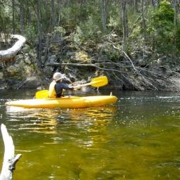student kayaking