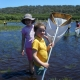 Students using dip nets in the lake