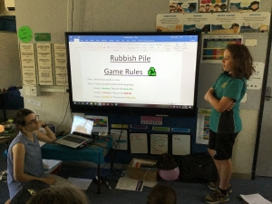 Students describing a game about waste